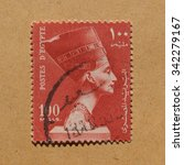 Small photo of CAIRO, EGYPT - NOVEMBER 21, 2015: A stamp printed by Egypt shows the Queen Nefertiti wife of Egyptian Pharaoh Akhenaten