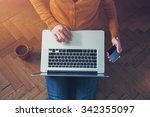 laptop and phone in hands. view ... | Shutterstock . vector #342355097