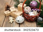 basket with christmas baubles... | Shutterstock . vector #342523673