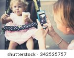 mother takes a photo of her... | Shutterstock . vector #342535757