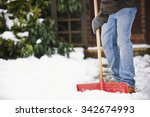 Man Clearing Snow From Path...