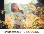 beautiful girl in the autumn... | Shutterstock . vector #342703337