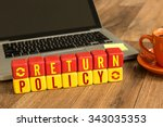 Small photo of Return Policy written on a wooden cube in a office desk