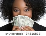 Woman Hiding Behind Money