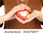 red apple with heart in female...   Shutterstock . vector #343270877