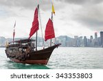 A Chinese Junk Ship With Red...