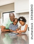father using tablet with his... | Shutterstock . vector #343468043