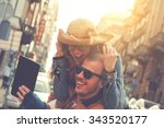 couple doing selfie outdoors. | Shutterstock . vector #343520177