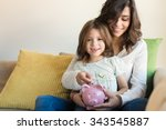 mother and daughter putting... | Shutterstock . vector #343545887