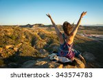 a girl sitting on a cliff... | Shutterstock . vector #343574783