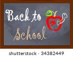 back to school on chalkboard... | Shutterstock .eps vector #34382449