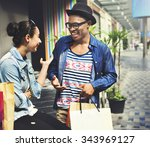 couple shopping outdoors store... | Shutterstock . vector #343969127