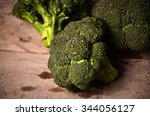large green broccoli on a black ...   Shutterstock . vector #344056127
