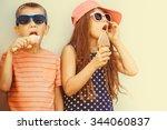 kids eating gelato and soft... | Shutterstock . vector #344060837