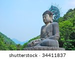 huge buddha statue surrounded...   Shutterstock . vector #34411837