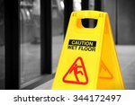 Bright Yellow Caution Sign Of...