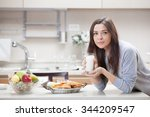 young woman with milk in the... | Shutterstock . vector #344209547