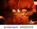Buddhist Monk Hands Holding...