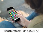 woman holding a smartphone... | Shutterstock . vector #344550677
