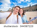romantic young couple with map... | Shutterstock . vector #344587223