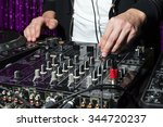 dj at dance party mixes track... | Shutterstock . vector #344720237