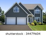 A new family home in a subdivision. - stock photo