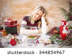 woman tired of gift wrapping | Shutterstock . vector #344854967
