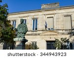 "Small photo of Bordeaux, France, October 25, 2015 : A listed monument Girl School of La Bastide area of Bordeaux, with the statue of Dr Le Chabrely (1835-1895), the altruistic ""Doctor of the poor""."