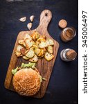 tasty burger on cutting board...   Shutterstock . vector #345006497