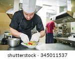 male cook chef decorating... | Shutterstock . vector #345011537