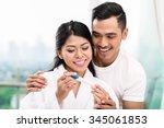 asian woman surprising her... | Shutterstock . vector #345061853