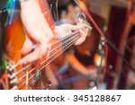 aggressive play guitar on stage | Shutterstock . vector #345128867