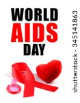 Small photo of Aids ribbon, condom and heart on white background.