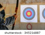 archer is aiming the arrow of... | Shutterstock . vector #345216887