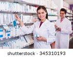 positive pharmacist and... | Shutterstock . vector #345310193