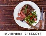 ribeye steak with arugula and... | Shutterstock . vector #345333767
