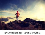 young woman hiker hiking on... | Shutterstock . vector #345349253