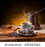 coffee cup and saucer on a... | Shutterstock . vector #345365363