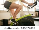 Stock photo cropped shot of fitness woman working out on exercise bike at the gym female exercising on bicycle 345372893