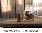 save idea  gold coins in a... | Shutterstock . vector #345382703