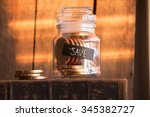 save idea  gold coins in a... | Shutterstock . vector #345382727