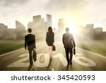 Group Of Three Businesspeople...