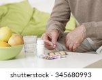 ailing old man taking pills... | Shutterstock . vector #345680993