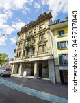 Small photo of THUN, SWITZERLAND - SEPTEMBER 08, 2015: The massive building with a decorated facade. The ground floor La Perla restaurant located in the city, its terrace situated on the banks of the Aare River