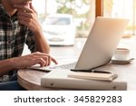 businessman using laptop with... | Shutterstock . vector #345829283