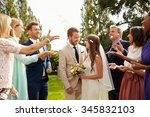guests throwing confetti over... | Shutterstock . vector #345832103