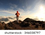 young woman hiker hiking on... | Shutterstock . vector #346038797