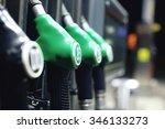green fuel pistols on fuel... | Shutterstock . vector #346133273