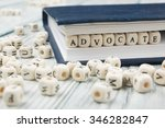 Small photo of Advocate word written on wood block