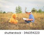 cute girl reading book teddy... | Shutterstock . vector #346354223